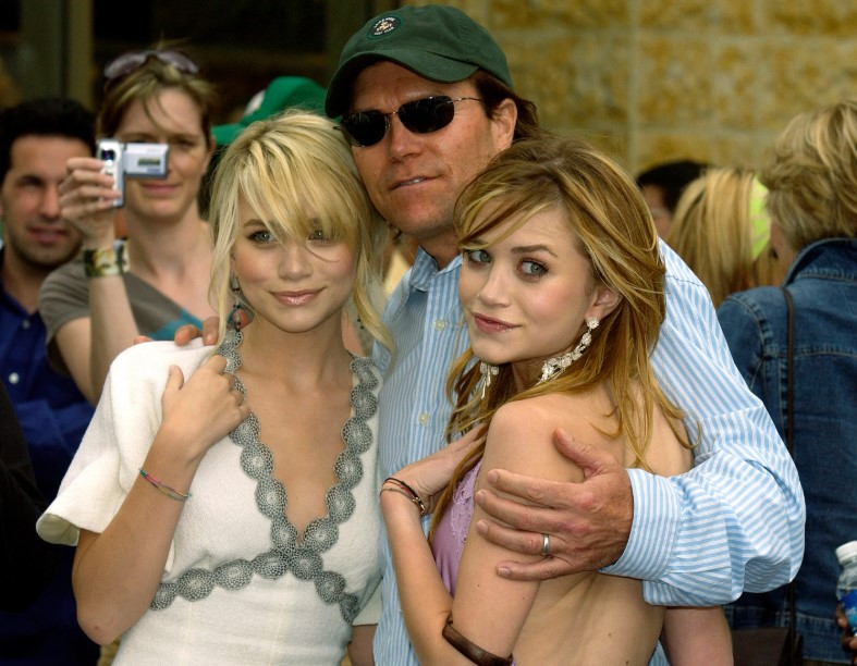 Mary Kate and her twin sister Ashely with their father.